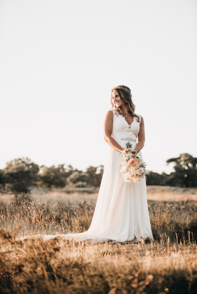 woman in wedding dress and hold flowers