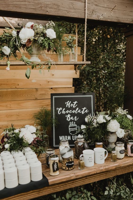 Christmas Wedding Decor Ideas: Hot Chocolate Bar Decorated with Greeneries