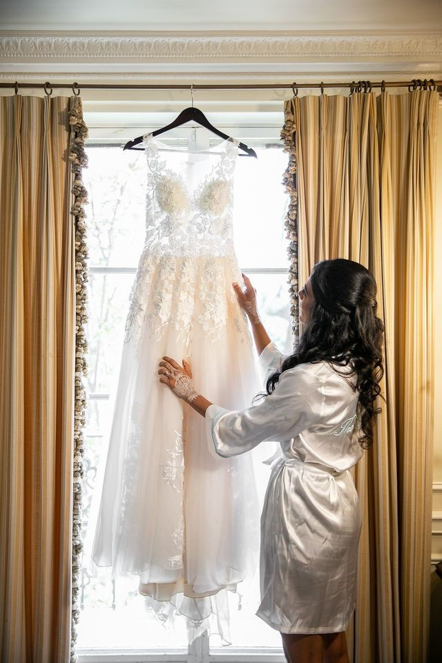 Bride Appreciating the Beauty of Her Wedding Dress