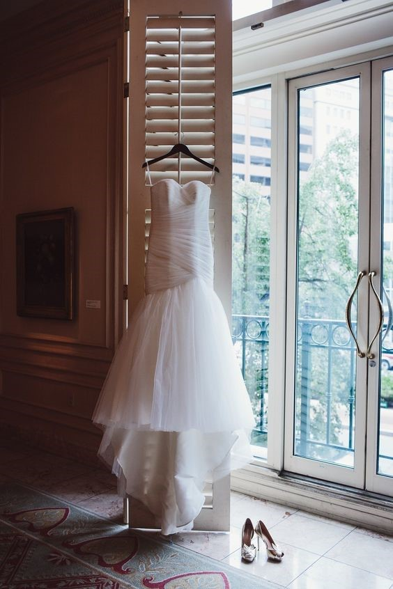 Beautiful Hanging Wedding Dress and Wedding Shoes