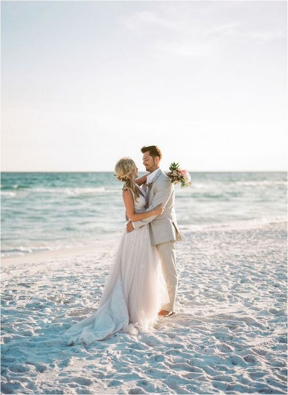 Beach Wedding Theme with Blue Ocean and Gold Sand