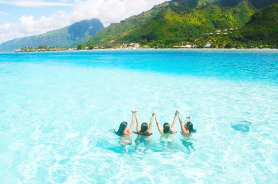 Four Girls Swimming in Blue Water