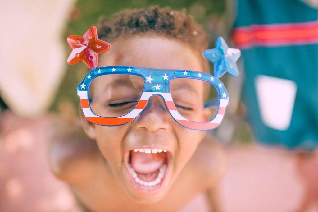 Happy kid with crafty sunglasses