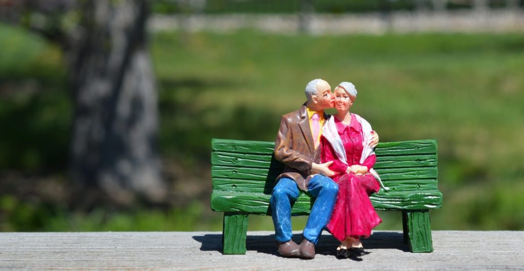 The old couple sitting on the bench.