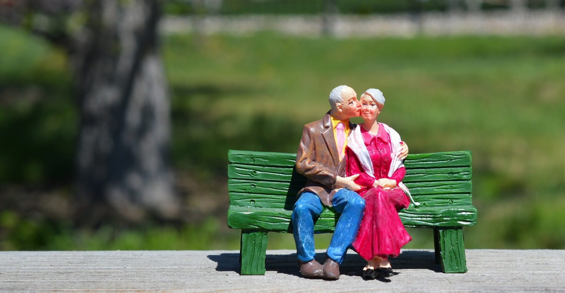 The old couple sitting on the bench