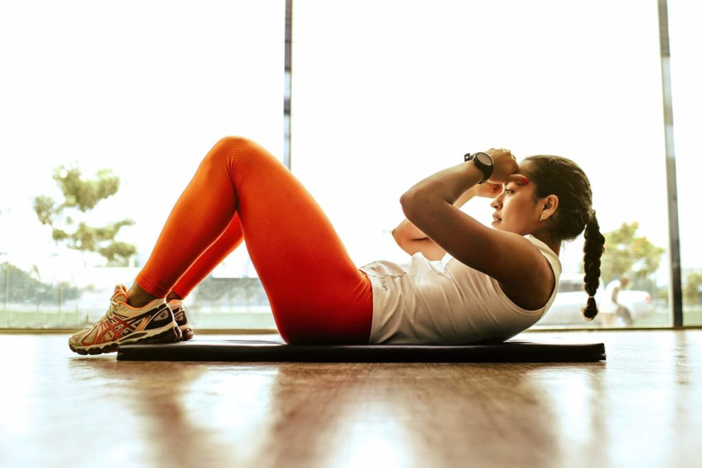 Women in red leggings working out