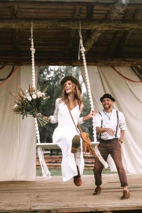 Happly couples in causal rustic wedding style enjoy their time