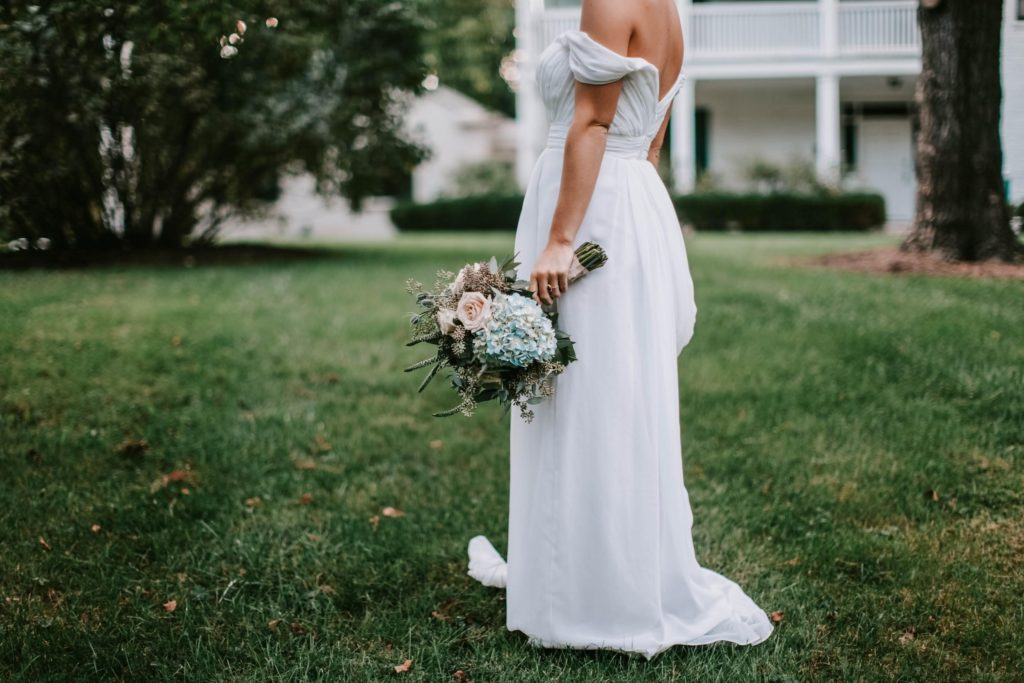 A woman standing in her wedding dress