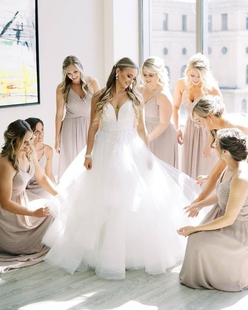 Bridesmaid Help the Bride to Get Dressed