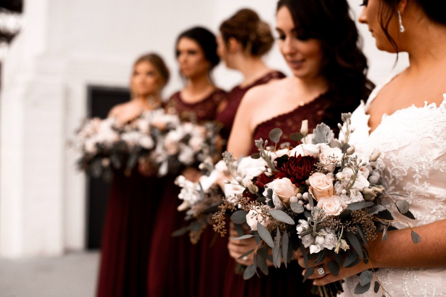 Bridesmaids dressed up at the wedding, holding bouquets