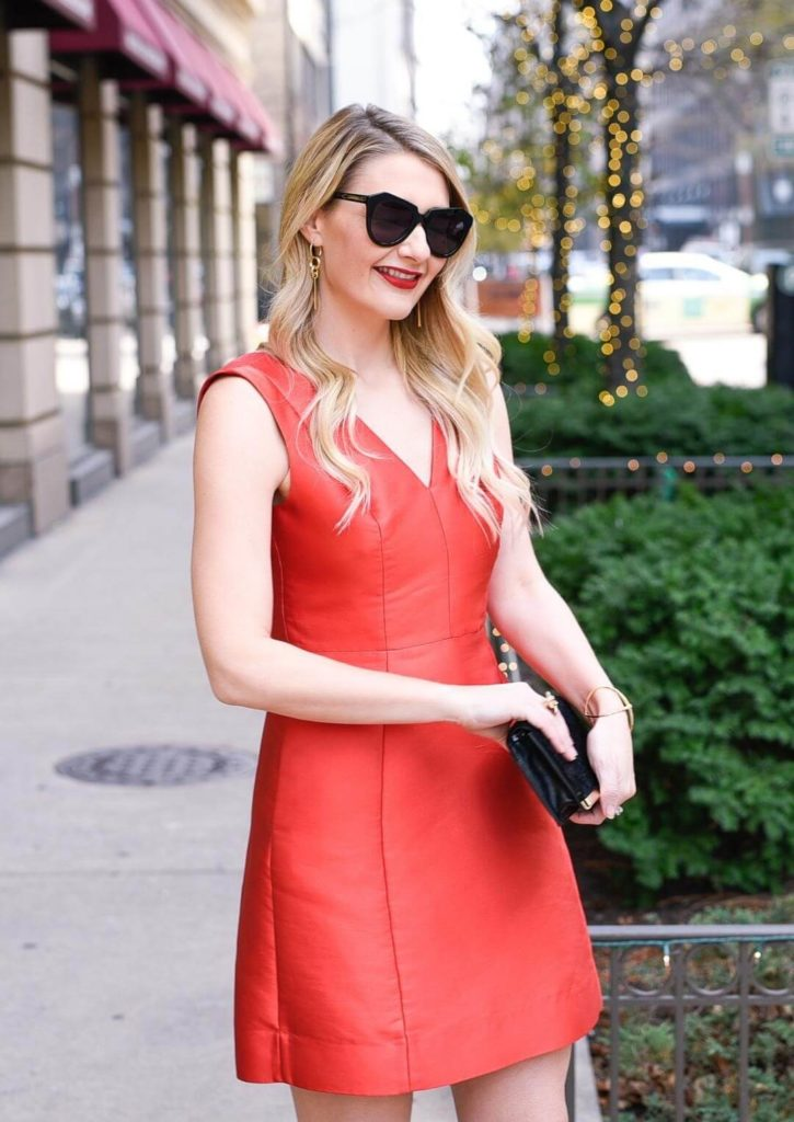 Red Leather V-neck Mini Dress for Wow Looks, Paired with Black Clutch