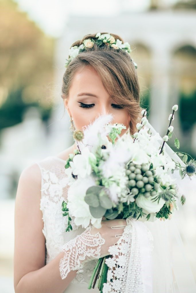 The Pretty Bride Holding Her Nature-Inspired Bridal Bouquet
