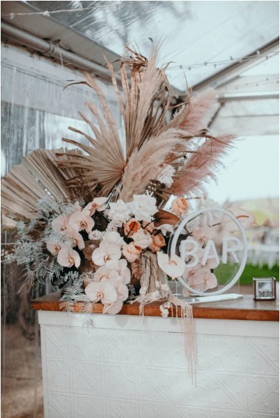 Wedding bar decorated with artificial flowers