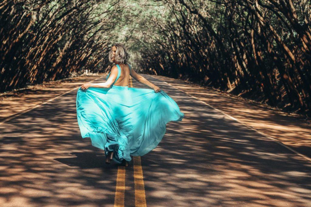 Woman in an evening dress running