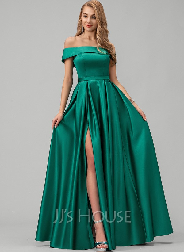 Emerald green dress with a side slit