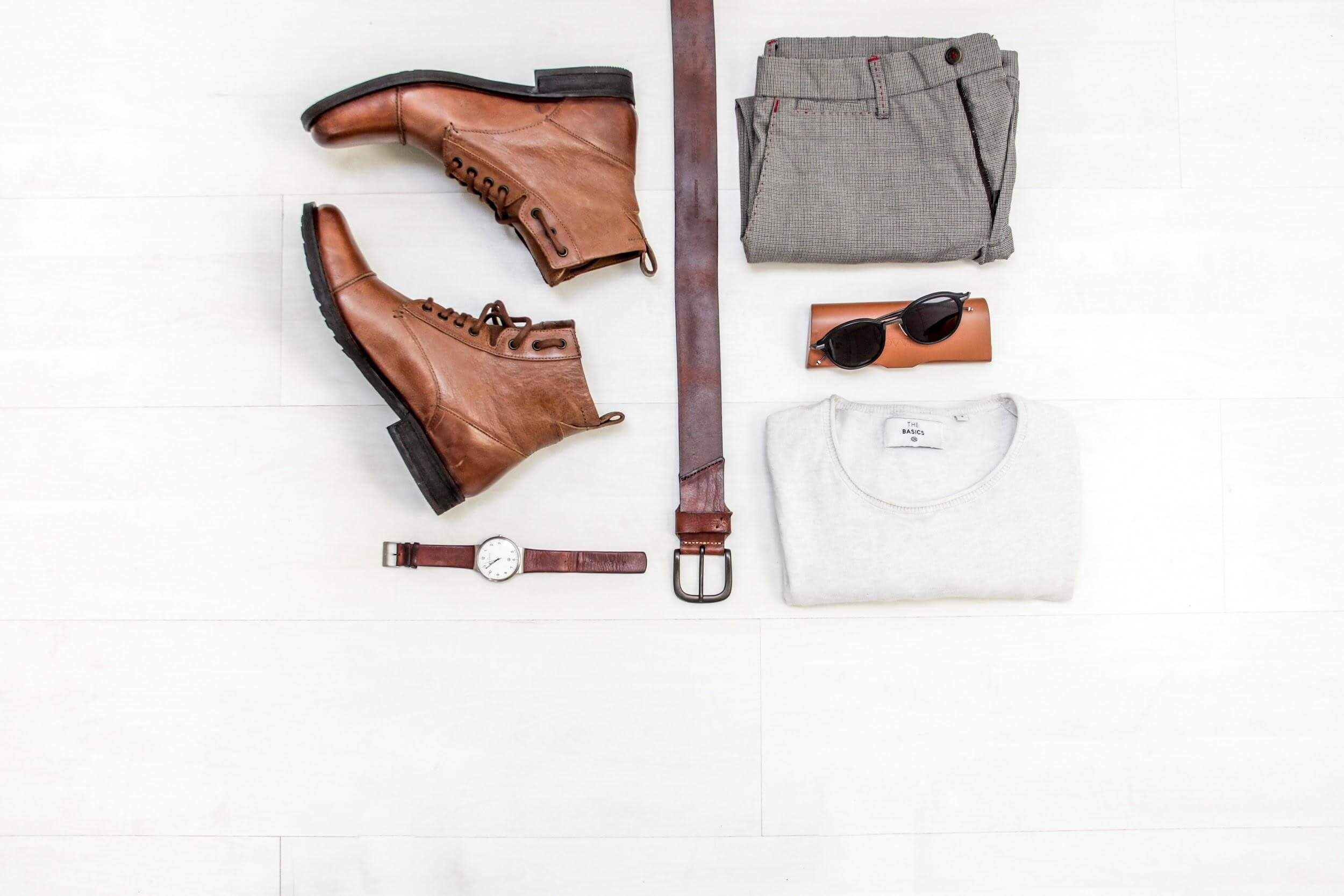 Flatlay of men's accessories and clothes