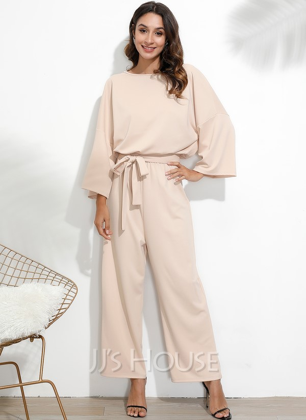 Beige jumpsuit with a bow belt