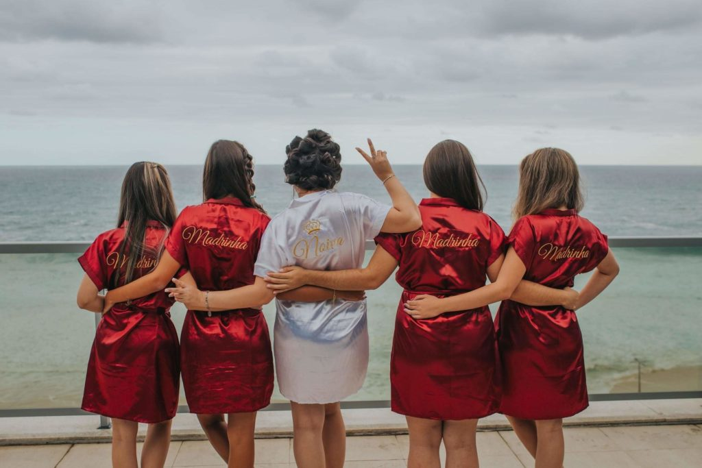 Bride with her bridesmaids, all in robes