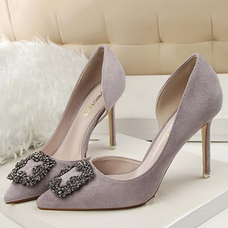 Suede pumps with rhinestones at the front